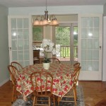 View of dining room, sun porch and deck