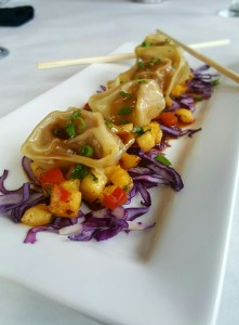Asian Pork Dumplings over a tropical fruit salsa with a honey-tamari glaze.