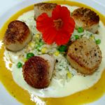 Seared Scallops with sweet corn, English pea, and fresh fennel risotto.
