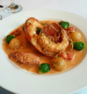 Pan Roasted Lobster with rosemary cream, boiled potatoes and local organic brussel sprouts